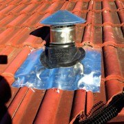 Aluminium flashing for a tiled roof